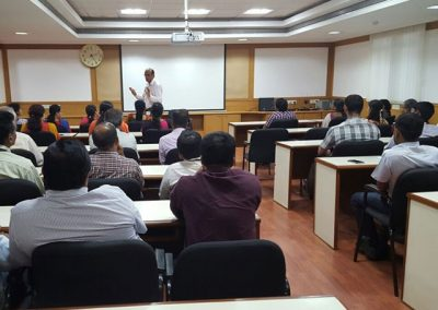 Dr.Navaneesh-Prasad-delivering-a-lecture-to-the-staff-at-ABB-640x460